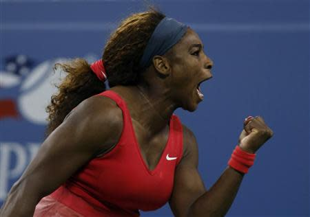 Serena Williams of the U.S. celebrates a point against Azarenka of Belarus during their women's singles final match at the U.S. Open tennis championships in New York