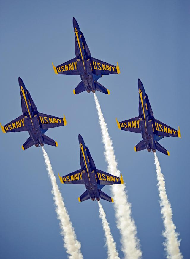 KEY WEST, FL - MARCH 24: In this photo provided by the Florida Keys News Bureau,the U.S. Navy's Blue Angels perform their precision aerobatics over the Florida Keys during the Southernmost Air Spectacular at Naval Air Station Key West on March 24, 2013, in Key West, Florida. The weekend air show concludes Sunday, March 24, and may mark the the last Blue Angels performance through the end of September 2013 due to sequester budget cuts. (Rob O'Neal/Florida Keys News Bureau via Getty Images)