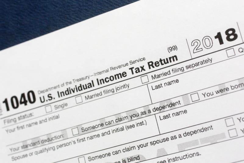 FILE- This July 24, 2018, file photo shows a portion of the 1040 U.S. Individual Income Tax Return form for 2018 in New York. The $1.5-trillion tax overhaul includes the end of a 75-year-old deduction on alimony payments. It may seem too early to start thinking about your tax return, but procrastination could cost you thousands of dollars. (AP Photo/Mark Lennihan, File)