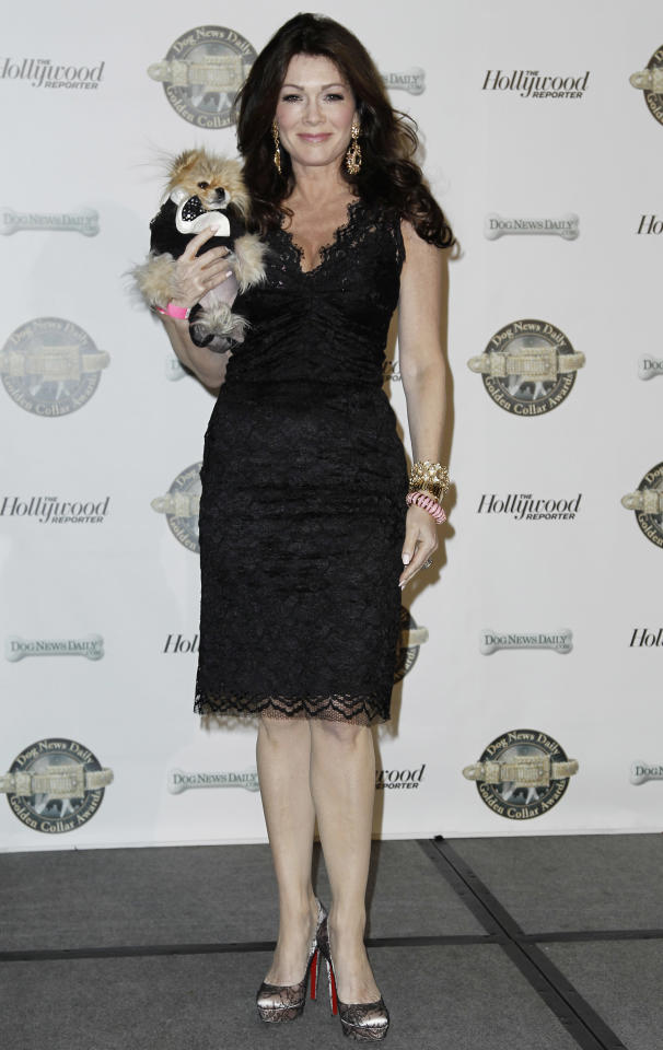 """Lisa Vanderpump, from Bravo TV's """"The Real Housewives of Beverly Hills,"""" and her dog Giggy arrive at the first annual Golden Collar Awards in Los Angeles, Monday, Feb. 13, 2012. The Golden Collar awards recognize the work of dogs in film and television. (AP Photo/Matt Sayles)"""