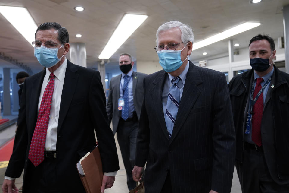 Sen. John Barrasso, R-Wyo., left, walks with Senate Minority Leader Mitch McConnell of Ky., on Capitol Hill in Washington, Friday, Feb. 12, 2021, on the fourth day of the second impeachment trial of former President Donald Trump. (AP Photo/Susan Walsh)