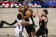 Brooklyn Nets center DeAndre Jordan (6) and Nets forward Joe Harris (12) defend Sacramento Kings guard Buddy Hield (24) during the first quarter of an NBA basketball game, Tuesday, Feb. 23, 2021, in New York. (AP Photo/Kathy Willens)