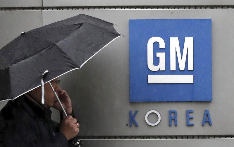 A worker of GM Korea talks on the mobile phone at GM Korea's factory in Bupyeong, South Korea, Monday, April 23, 2018. General Motors says it has reached a tentative agreement with its South Korean labor union to a set of measures to cut costs and allocate new car models to existing GM Korea factories. (Lim Tae-hoon/Newsis via AP)