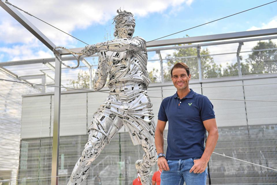 Nadal poses with his new statue (Christophe Guibbaud / FFT)