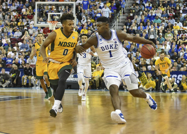 <p>Duke's Zion Williamson (1) steals the ball away from North Dakota State's Vinnie Shahid (0) during the second half of a first round men's college basketball game in the NCAA Tournament in Columbia, S.C. Friday, March 22, 2019. (AP Photo/Richard Shiro) </p>
