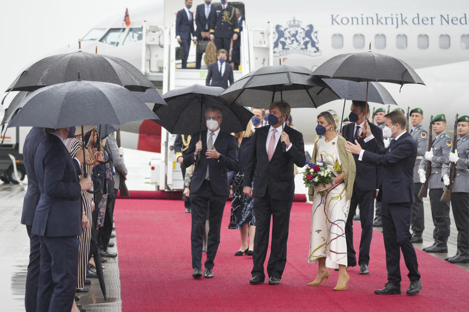 King Willem-Alexander of the Netherlands and Queen Maxima arrive at the Brandenburg Airport in Berlin, Germany, Monday, July 5, 2021. The Royals arrived in Germany for a three-day visit that was delayed from last year because of the coronavirus pandemic. (Kay Nietfeld/dpa via AP)