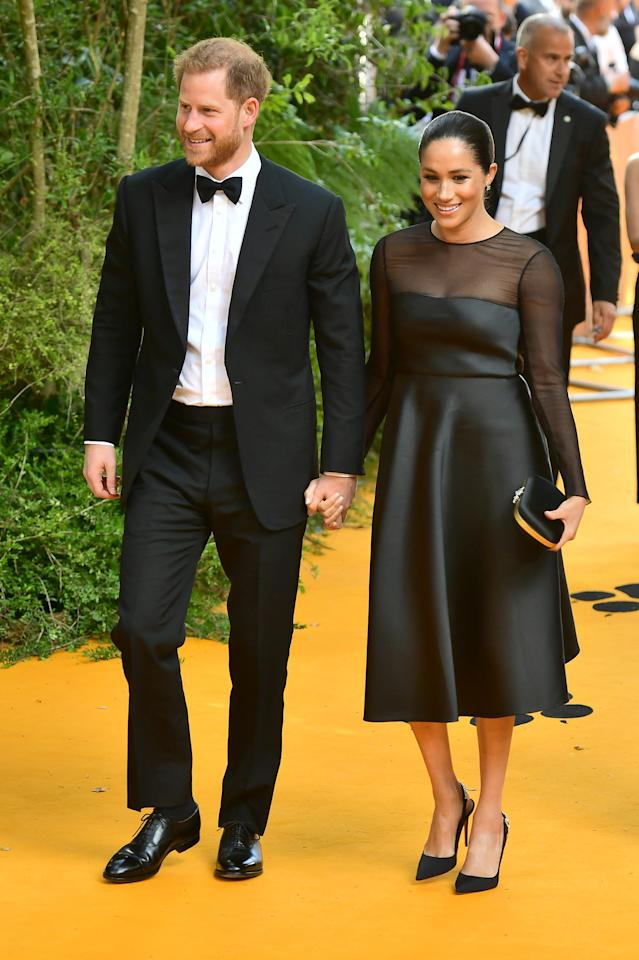 For the UK premiere of 'The Lion King', the Duchess of Sussex wore a £3,454 black satin dress with sheer sleeves by Jason Wu. A co-ordinating £1,680 Gucci clutch and matching shoes completed the winning ensemble. [Photo: Getty]
