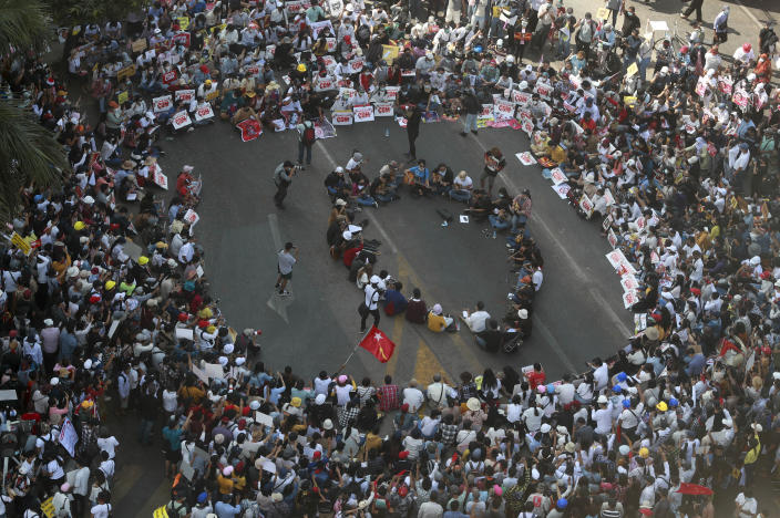 Demonstrators gather in an intersection to protest against the military coup in Yangon, Myanmar Wednesday, Feb. 17, 2021. The U.N. expert on human rights in Myanmar warned of the prospect for major violence as demonstrators gather again Wednesday to protest the military's seizure of power. (AP Photo)