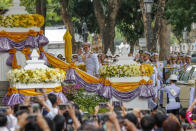 King Maha Vajiralongkorn, center, waves as he arrives to participate in a graduation ceremony at Thammasat University in Bangkok, Thailand, Friday, Oct. 30, 2020. (AP Photo/Sakchai Lalit)