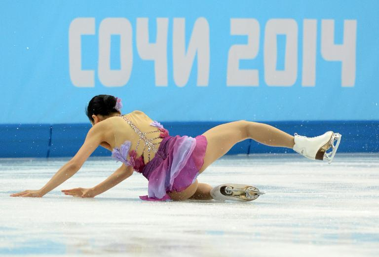 Japan's Mao Asada falls as she performs in the Women's Figure Skating Team Short Program at the Iceberg Skating Palace during the 2014 Sochi Winter Olympics on February 8, 2014