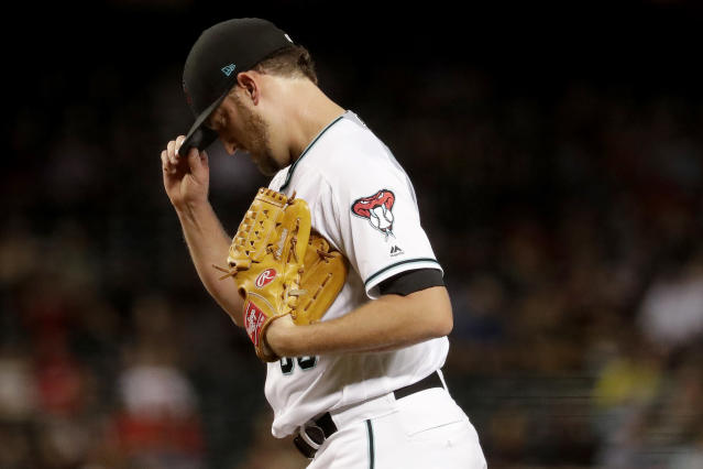 Arizona Diamondbacks relief pitcher Matt Andriese adjusts his cap after giving up a three-run double to the Miami Marlins during the sixth inning of a baseball game Tuesday, Sept. 17, 2019, in Phoenix. (AP Photo/Matt York)