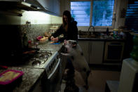 Luciana Benetti, 16, feeds her pet pig Chanchi, given to her for a birthday present the previous year during the COVID-19 pandemic, in Buenos Aires, Argentina, Saturday, Sept. 4, 2021. Chanchi has turned out to be a loyal and loving companion — racing to her side when she fainted. (AP Photo/Natacha Pisarenko)