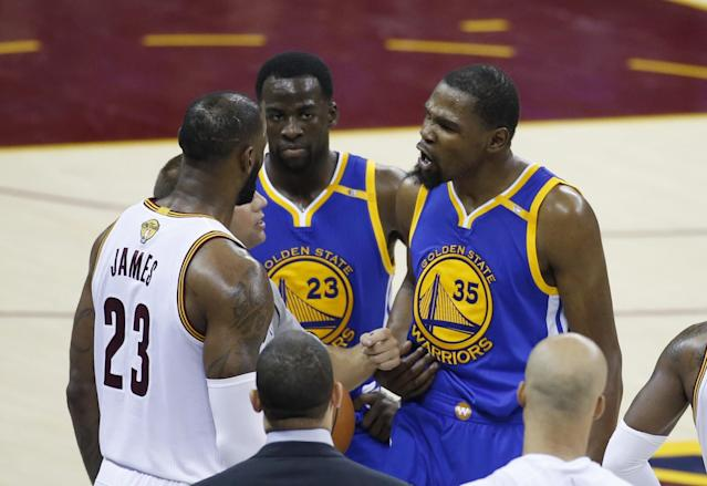 <p>Golden State Warriors forward Kevin Durant (35) argues with Cleveland Cavaliers forward LeBron James (23) during the second half of Game 4 of basketball's NBA Finals in Cleveland, Friday, June 9, 2017. (AP Photo/Ron Schwane) </p>