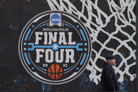 FILE - The NCAA Final Four logo for the NCAA college basketball tournament is painted on a window in downtown Indianapolis, in this Wednesday, March 17, 2021, file photo. The Associated Press has learned that the NCAA has not tested players for performance-enhancing drugs while they've been at March Madness and other recent college championships. Three people familiar with testing protocols tell AP full-scale testing has not resumed since the coronavirus pandemic shut down college sports a year ago. (AP Photo/Darron Cummings, File)