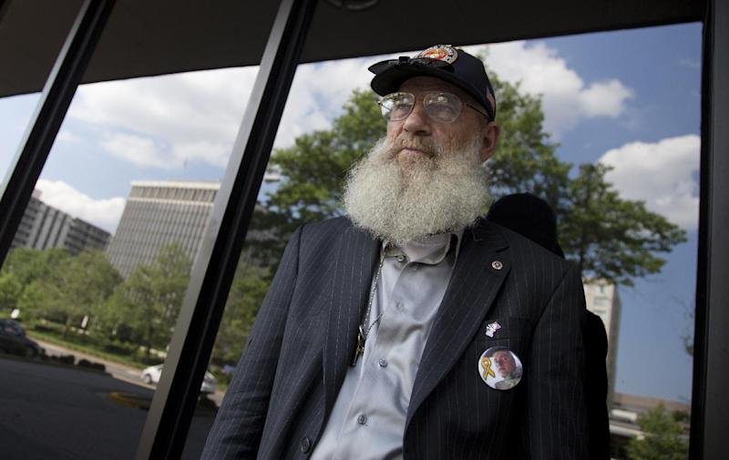 Keith Maupin, father of Sgt. Matt Maupin, is photographed, Arlington, Va.,Tuesday, May 13, 2014. A man in Iraqi custody has confessed to killing Sgt. Matt Maupin whose remains were found in 2008. Sgt. Matt Maupin, of Batavia in southwestern Ohio, was captured when insurgents with rocket-propelled grenades and small arms ambushed his fuel convoy near Baghdad on April 9, 2004. Keith Maupin decided to grow his beard until his son came home. He has never cut it. (AP Photo)