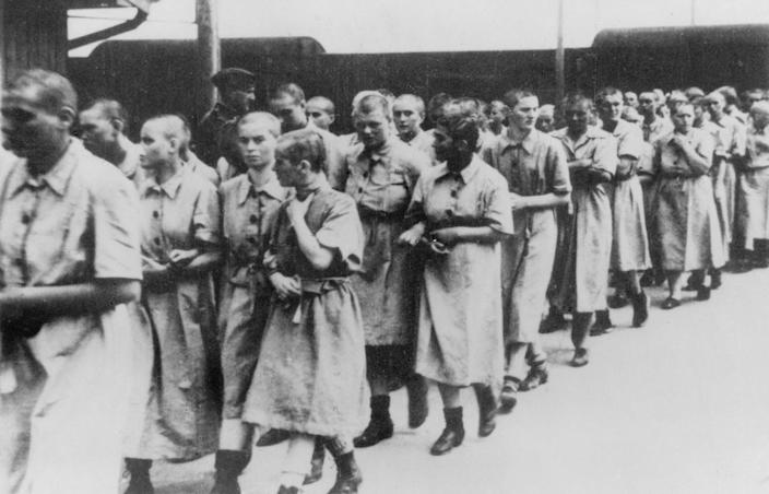 "<span class=""caption"">Women prisoners at the Auschwitz train station around 1944. </span> <span class=""attribution""><a class=""link rapid-noclick-resp"" href=""https://www.gettyimages.com/detail/news-photo/germany-third-reich-concentration-camps-1939-45-women-at-news-photo/545959785?adppopup=true"" rel=""nofollow noopener"" target=""_blank"" data-ylk=""slk:ullstein bild via Getty Images"">ullstein bild via Getty Images</a></span>"