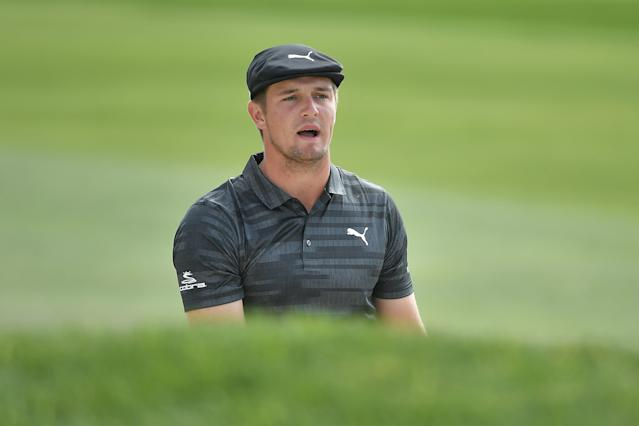 "<div class=""caption""> Bryson DeChambeau looks on after hitting a shot from a bunker on the 13th hole during the first round of the 2018 Farmers Insurance Open. </div> <cite class=""credit"">Donald Miralle/Getty Images</cite>"