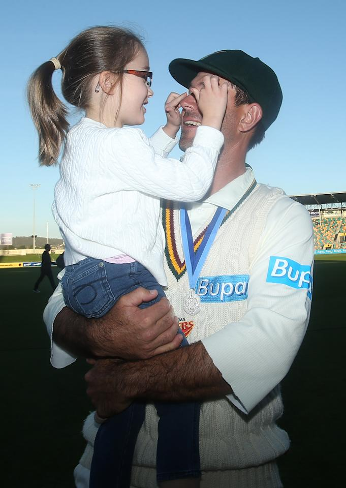 HOBART, AUSTRALIA - MARCH 26:  Ricky Ponting of the Tigers holds his daughter Emmy after victory in the Sheffield Shield final between the Tasmania Tigers and the Queensland Bulls at Blundstone Arena on March 26, 2013 in Hobart, Australia.  (Photo by Mark Metcalfe/Getty Images)