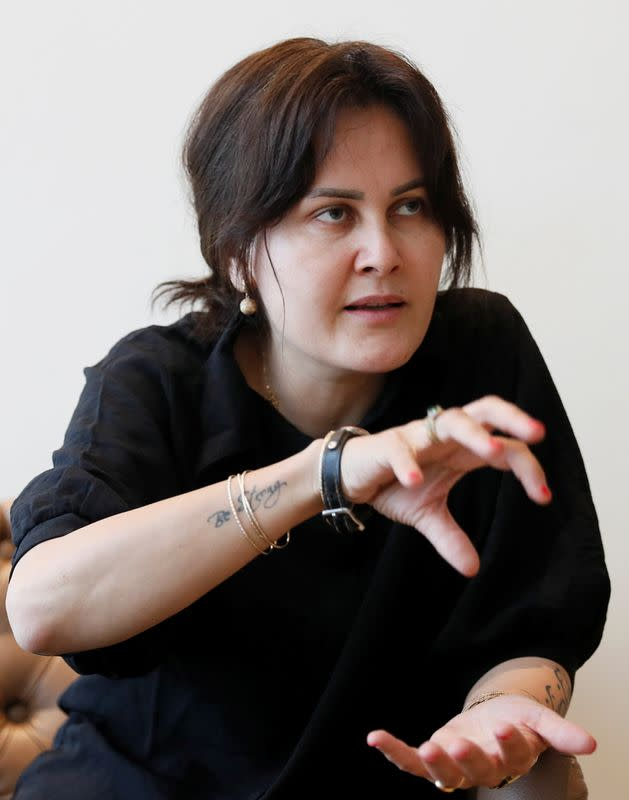 Afghan filmmaker Sahraa Karimi speaks during an interview with Reuters in Kyiv
