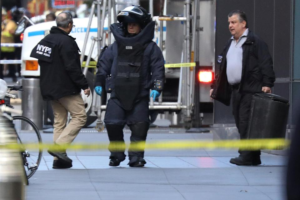 A member of the New York Police Department bomb squad outside the Time Warner Center in Manahattan after a suspicious package was found inside the CNN Headquarters in New York. (REUTERS/Kevin Coombs)