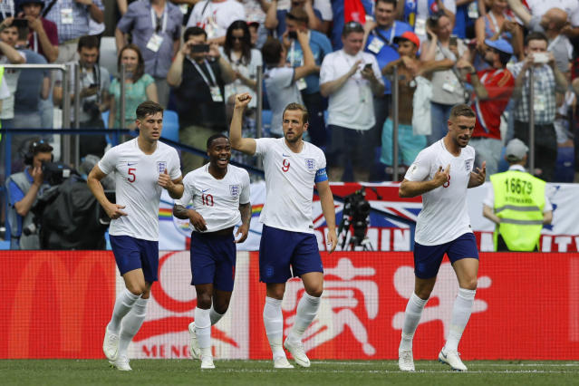 England's Harry Kane, center, celebrates with teammates after scoring his side's second goal during the group G match between England and Panama at the 2018 soccer World Cup at the Nizhny Novgorod Stadium in Nizhny Novgorod , Russia, Sunday, June 24, 2018. (AP Photo/Alastair Grant)