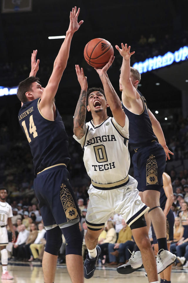 Georgia Tech guard Michael Devoe is double-teamed by Notre Dame defenders Nate Laszewski, left, and Rex Pflueger during the first half of an NCAA college basketball game Wednesday, Jan. 15, 2020, in Atlanta. (Curtis Compton/Atlanta Journal-Constitution via AP)
