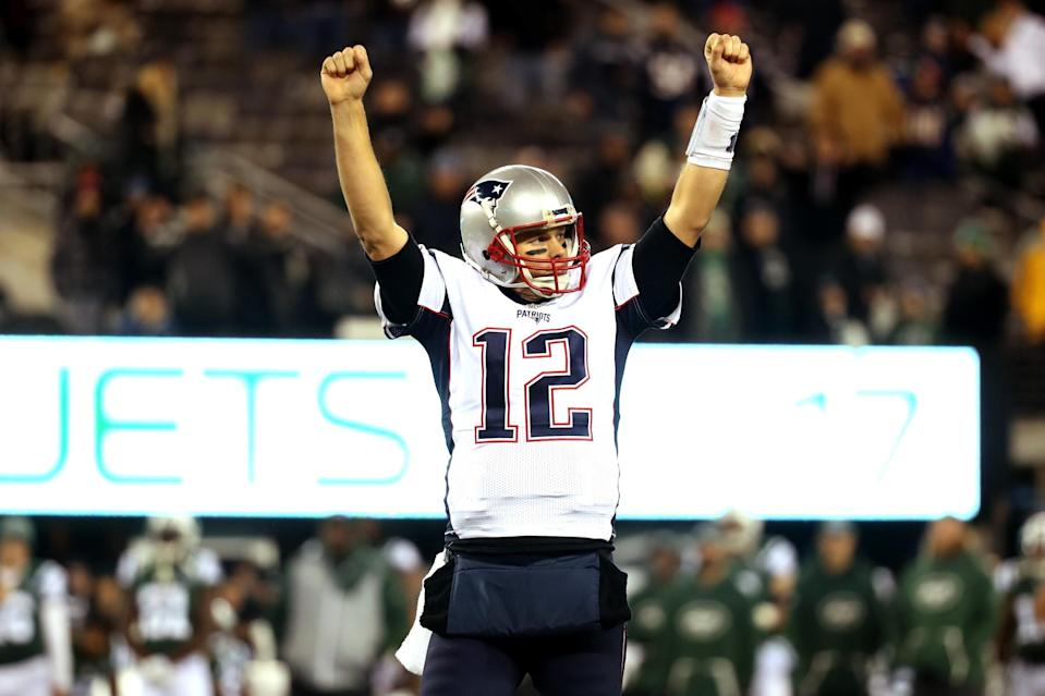 Victory: Tom Brady led the Patriots to a comeback win over the Jets. (Getty Images)
