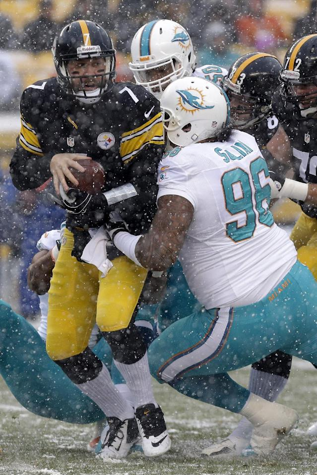 Pittsburgh Steelers quarterback Ben Roethlisberger (7) is sacked by Miami Dolphins defensive tackle Paul Soliai (96) during the first quarter of an NFL football game in Pittsburgh, Sunday, Dec. 8, 2013. (AP Photo/Tom E. Puskar)