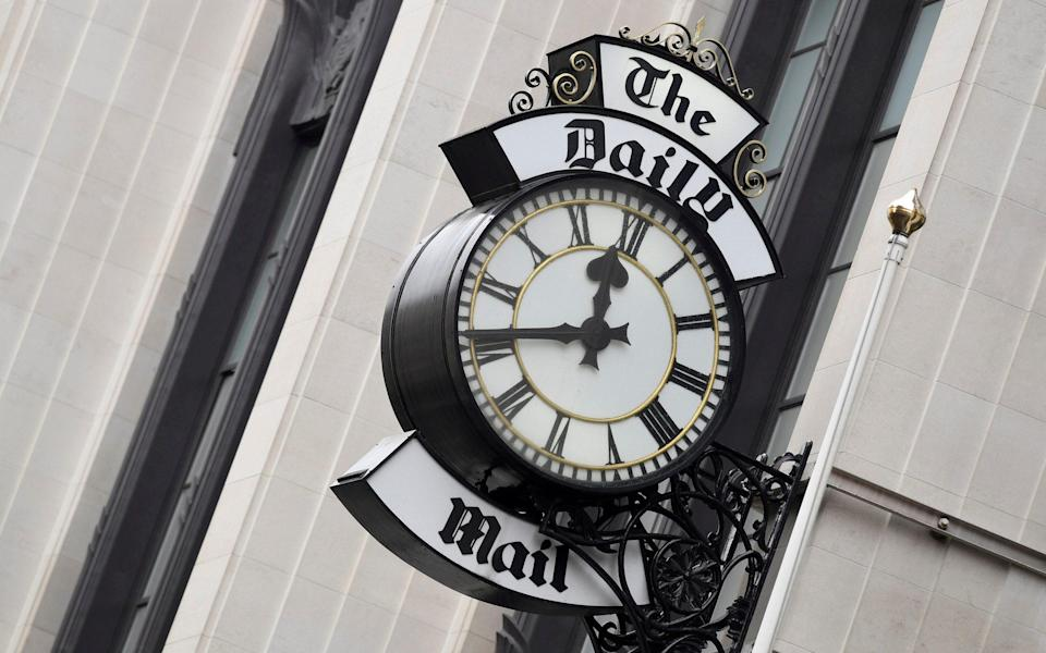 A clock face is seen outside of the London offices of the Daily Mail newspaper in London