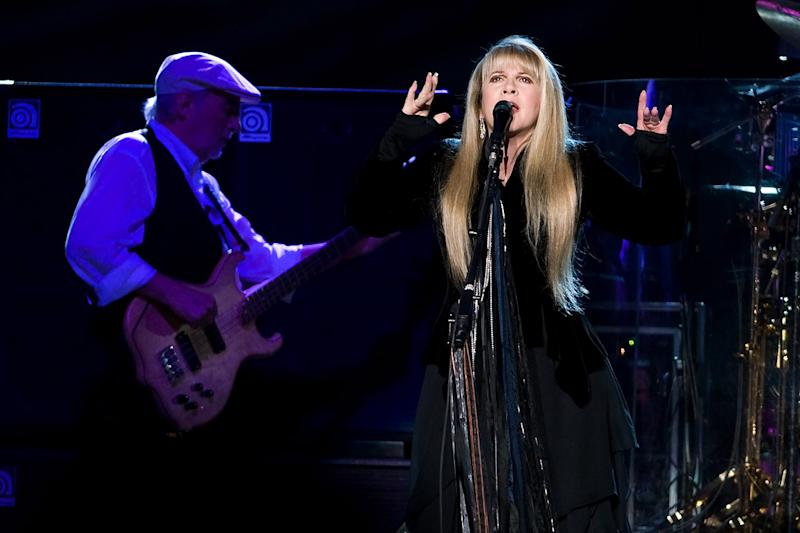 FILE - This March 19, 2009 file photo shows John McVie, left, and Stevie Nicks of Fleetwood Mac performing at Madison Square Garden in New York. Fleetwood Mac is heading back on the road with a 34-city U.S. tour kicking off April 3, 2013 in Columbus, Ohio. (AP Photo/Charles Sykes, file)