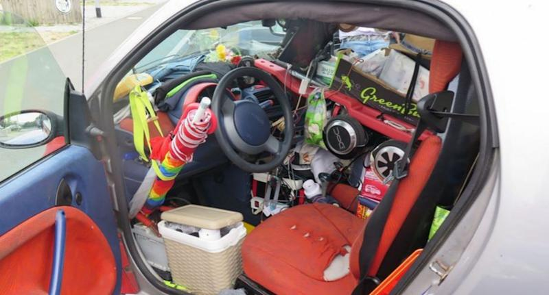 The Smart car German cops stopped from continuing its journey after they found it was completely packed full of household items - including around the pedals (CEN)