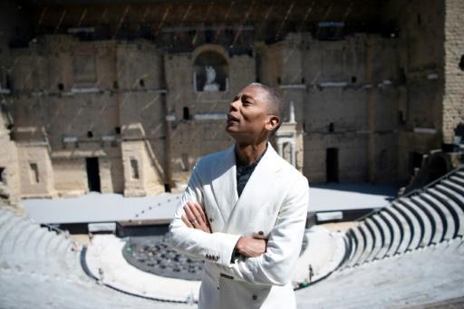 "Composer Jeff Mills, known as ""The Wizard"", is is performing with a classical music orchestra at the Orange music festival"