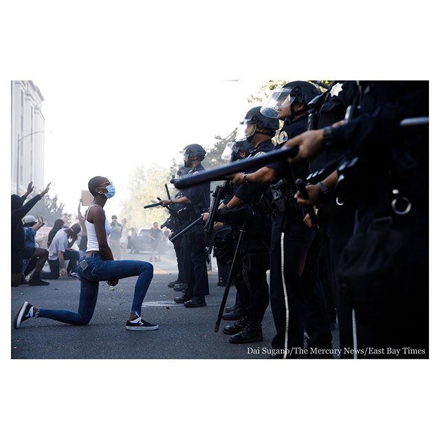 """<p>A protester takes a knee in front police officers.</p><p><a href=""""https://www.instagram.com/p/CA0STpYl9ZK/"""">See the original post on Instagram</a></p>"""