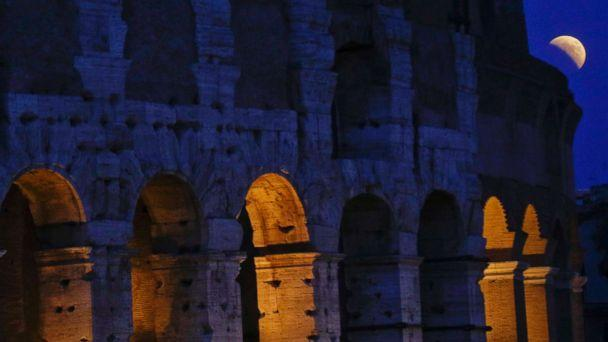 PHOTO: The moon rises over the Colosseum during a complete lunar eclipse, in Rome, July 27, 2018. (Gregorio Borgia/AP)