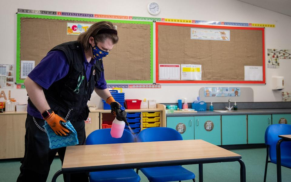 'Enhanced cleaning' regimes have been introduced in which surfaces students touch regularly, such as desks, door handles, books and playground apparatus are cleaned with bleach and detergents - Joe Giddens/PA