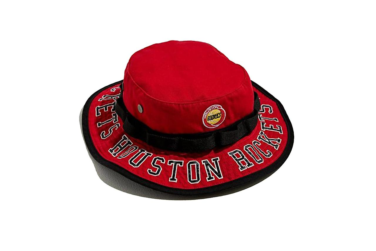 "$32, Urban Outfitters. <a href=""https://www.urbanoutfitters.com/shop/mitchell-ness-team-burst-houston-rockets-boonie-bucket-hat?category=latest-mens-fashion&color=060&type=REGULAR"">Get it now!</a>"