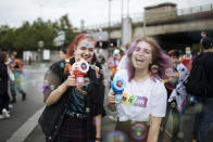 Participants use bubbles guns during the annual Gay Pride march in Paris, Saturday, June 26, 2021. This year's march in Paris comes amid widespread fury and concern in Europe about legislation in EU-member nation Hungary that will ban showing content about LGBT issues to children. (AP Photo/Lewis Joly)