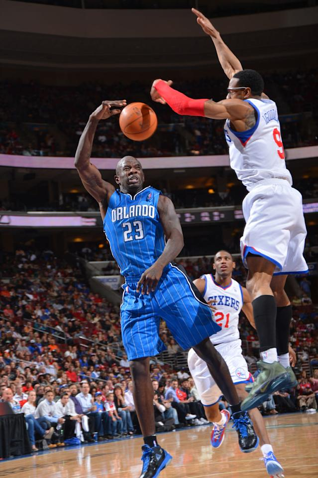 PHILADELPHIA, PA - APRIL 7: Jason Richardson #23 of the Orlando Magic passes the ball against Andre Iguodala #9 of the Philadelphia 76ers on April 7, 2012 at the Wells Fargo Center in Philadelphia, Pennsylvania.    NOTE TO USER: User expressly acknowledges and agrees that, by downloading and/or using this Photograph, user is consenting to the terms and conditions of the Getty Images License Agreement. Mandatory Copyright Notice: Copyright 2012 NBAE
