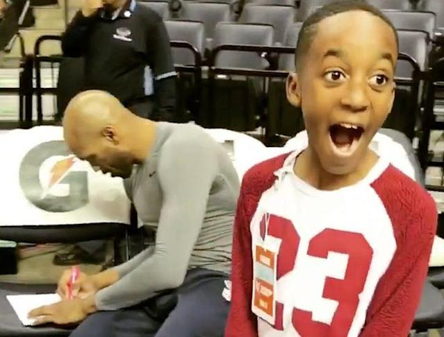 Memphis Grizzles forward Vince Carter sings an autograph for a very excited young fan. (Photo:Twitter/@memgrizz)