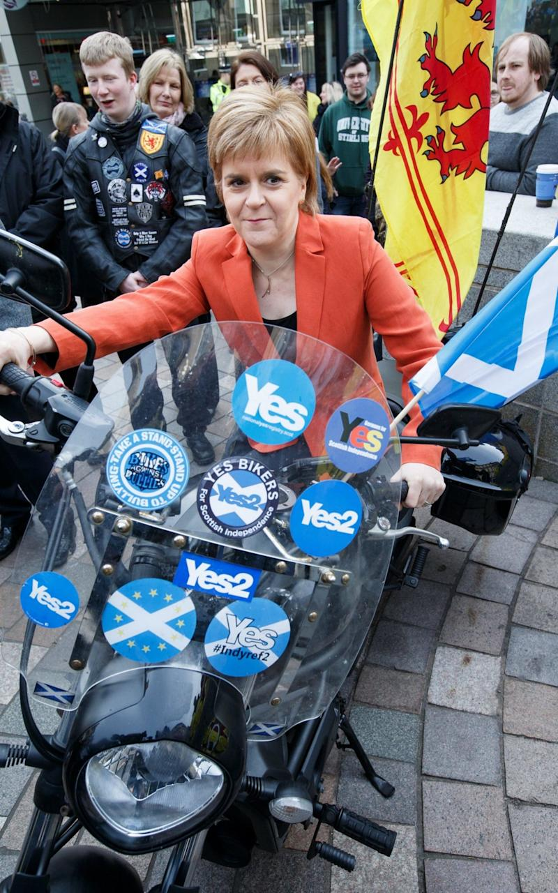 SNP leader Nicola Sturgeon poses on a motorcycle while on the campaign trail, in Stirling - Credit: EPA