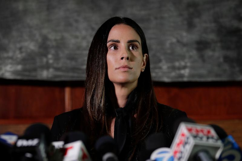 Former sports reporter Kelli Tennant attends a news conference Tuesday, April 23, 2019, in Los Angeles. Tennant filed the suit in Los Angeles County Superior Court on Monday, contending new Sacramento Kings coach Luke Walton assaulted her in a hotel room in Santa Monica while he was an assistant coach for the Golden State Warriors. (AP Photo/Jae C. Hong)