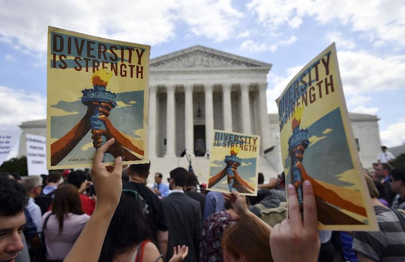 Demonstrators rallied outside the US Supreme Court as it decided to uphold President Donald Trump's controversial travel ban in a major victory for the Republican president (AFP Photo/MANDEL NGAN)