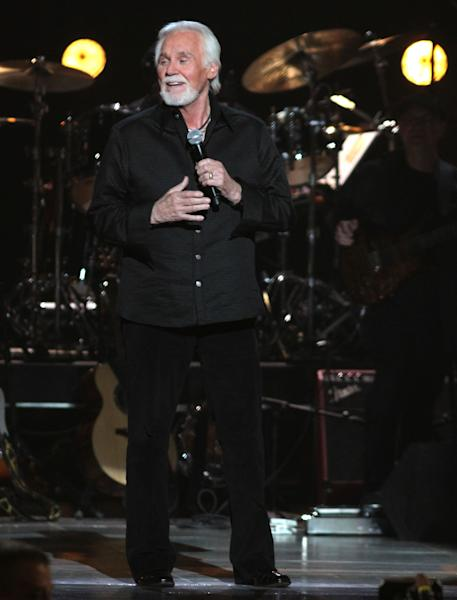 FILE - This April 2, 2012 file photo, singer Kenny Rogers performs at the ACM Presents: Lionel Richie and Friends in Concert in Las Vegas. The northeast Georgia home owned by country singer Kenny Rogers that was scheduled to be put up for auction has been sold. Grand Estates Auction Co. in Charlotte, N.C., says Rogers sold the house and its 150 acres Wednesday, June 27, for $2.25 million. The property is located near Nicholson, Ga., and included a 5,681-square-foot-house, a 2,675-square foot pool, an 8-acre lake, horse riding trails, go-cart track and other amenities. (AP Photo/Jeff Bottari, file)