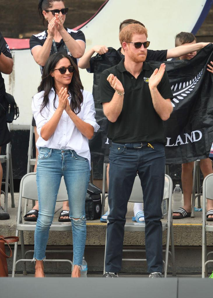 <p>Meghan chooses a light wash pair of denim jeans from Mother denim on her date with Prince Harry at the 2017 Invictus Games. (Photo: Karwai Tang/WireImage) </p>