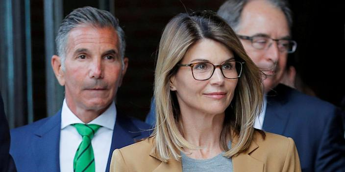 FILE PHOTO: Actor Lori Loughlin, and her husband, fashion designer Mossimo Giannulli, leave the federal courthouse after facing charges in a nationwide college admissions cheating scheme, in Boston, Massachusetts, U.S., April 3, 2019. REUTERS/Brian Snyder/File Photo