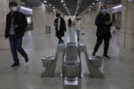 Residents walk through a subway station in Wuhan in central China's Wuhan province on Wednesday, April 1, 2020. Skepticism about China's reported coronavirus cases and deaths has swirled throughout the crisis, fueled by official efforts to quash bad news in the early days and a general distrust of the government. In any country, getting a complete picture of the infections amid the fog of war is virtually impossible. (AP Photo/Ng Han Guan)