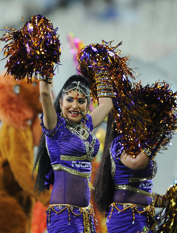 Dancers perform a routine before the start of the IPL Twenty20 cricket match between Kolkata Knight Riders and Delhi Daredevils at The Eden Gardens Cricket Stadium in Kolkata on April 5, 2012.  RESTRICTED TO EDITORIAL USE. MOBILE USE WITHIN NEWS PACKAGE.  AFP PHOTO/Dibyangshu SARKAR (Photo credit should read DIBYANGSHU SARKAR/AFP/Getty Images)