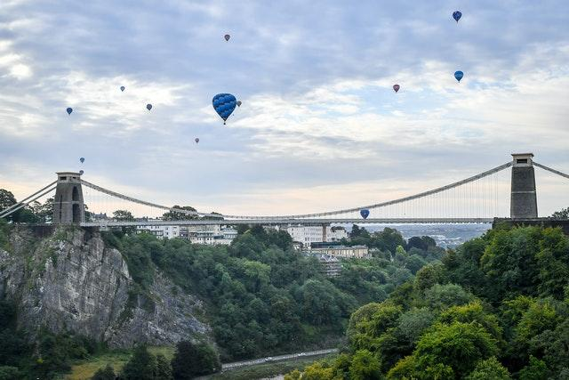 Balloons floating over the Clifton suspension bridge in Bristol