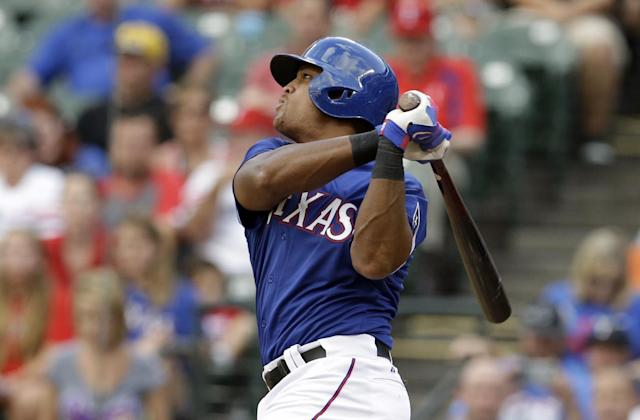 Texas Rangers third baseman Adrian Beltre watches the flight of his two-run home run that scored Shin-Soo Choo off a pitch from Minnesota Twins starting pitcher Kevin Correia in the first inning of a baseball game, Friday, June 27, 2014, in Arlington, Texas. (AP Photo/Tony Gutierrez)