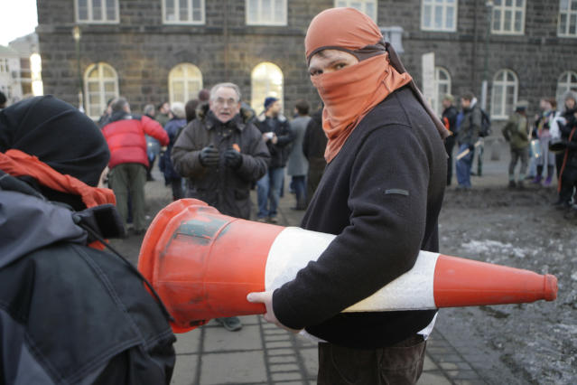 A demonstrator carries a cone during a protest in Reykjavik January 25, 2009. REUTERS/Ints Kalnins (ICELAND)